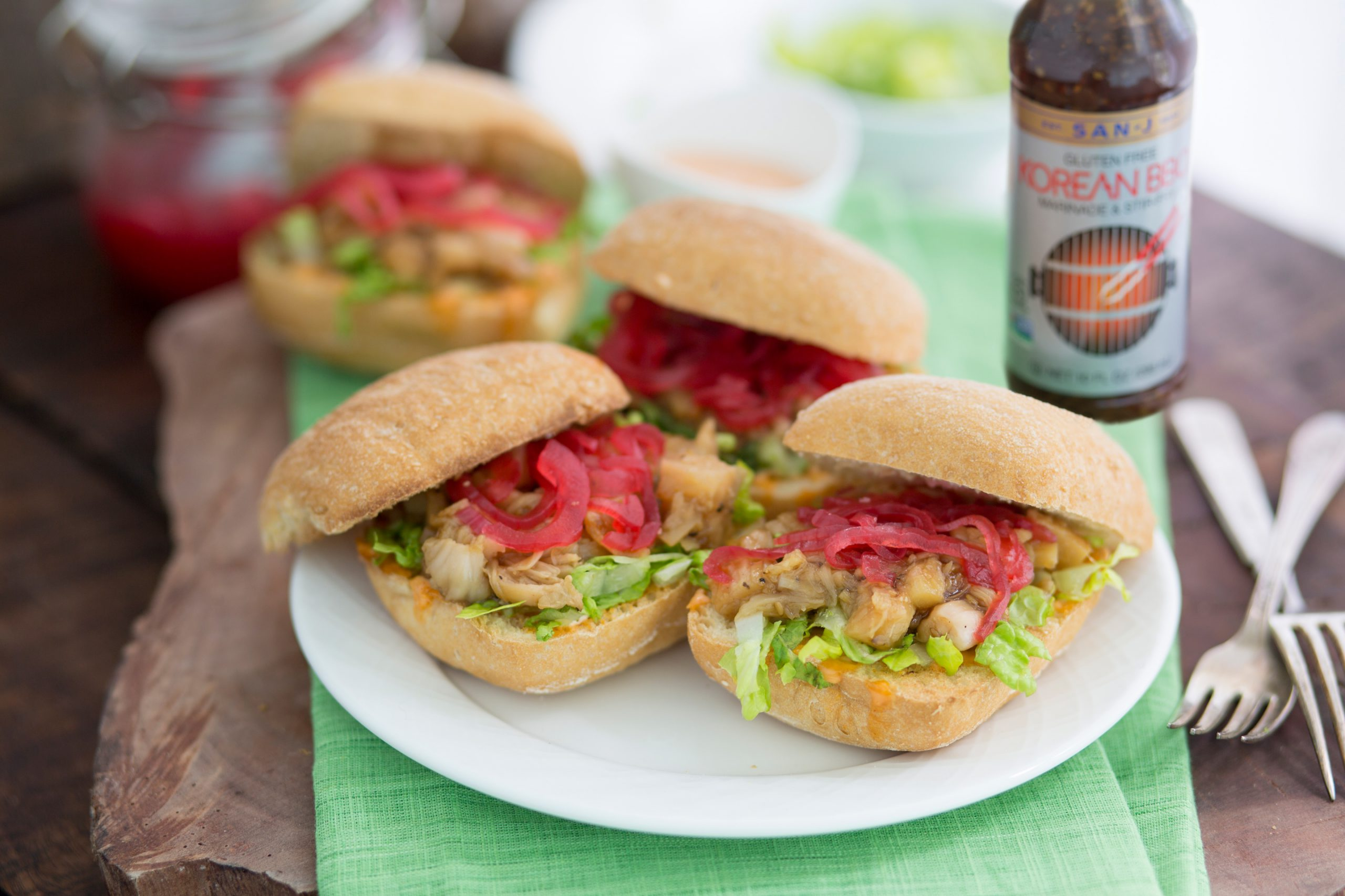 Korean BBQ Jackfruit Sliders on a plate with San-J Soy Sauce Bottle on a table