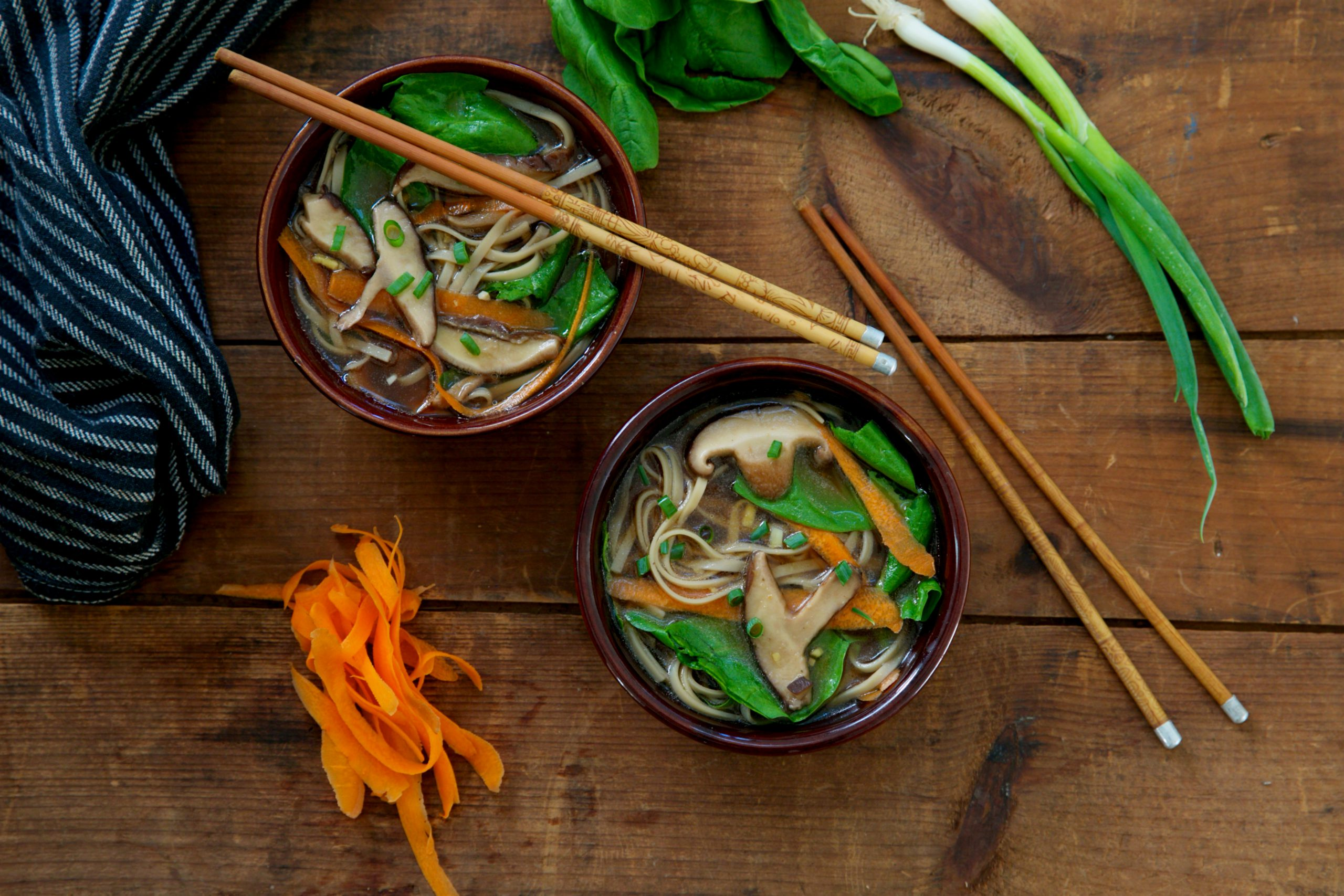 Japanese noodle soup in two bowls on a table by San-J