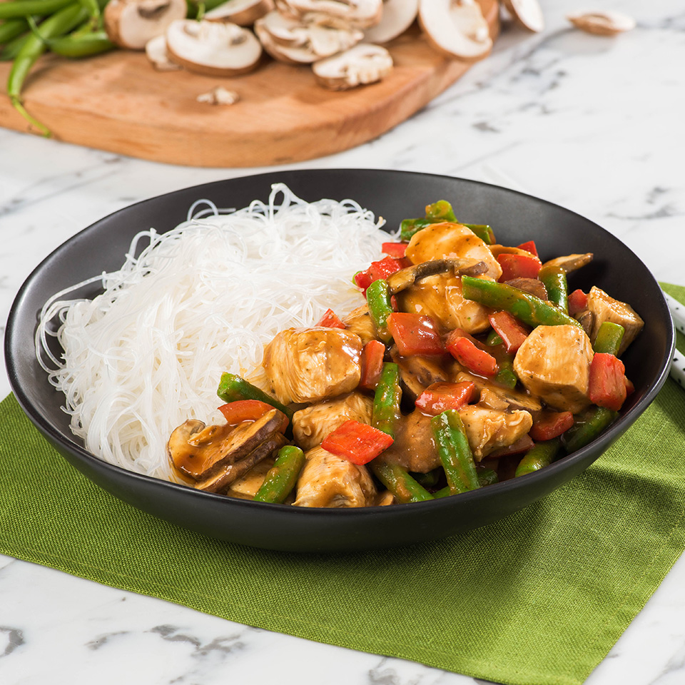 Thai peanut chicken stir fry in a bow with noodles by San-J