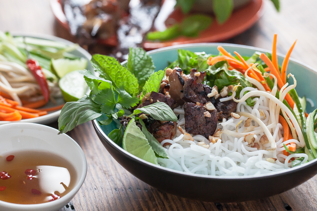 Vietnamese Noodles In a bowl with vegetables and San-J Soy Sauce