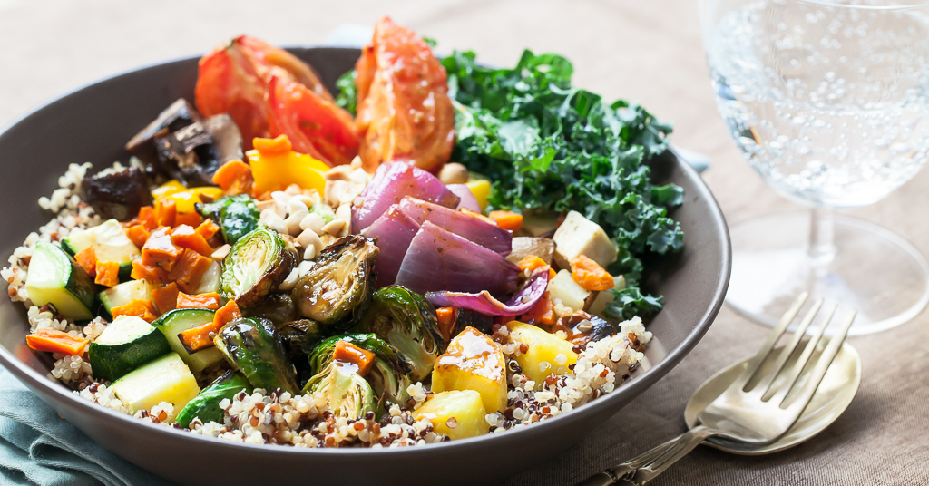 A buddha bowl filled with roasted vegetables by San-J